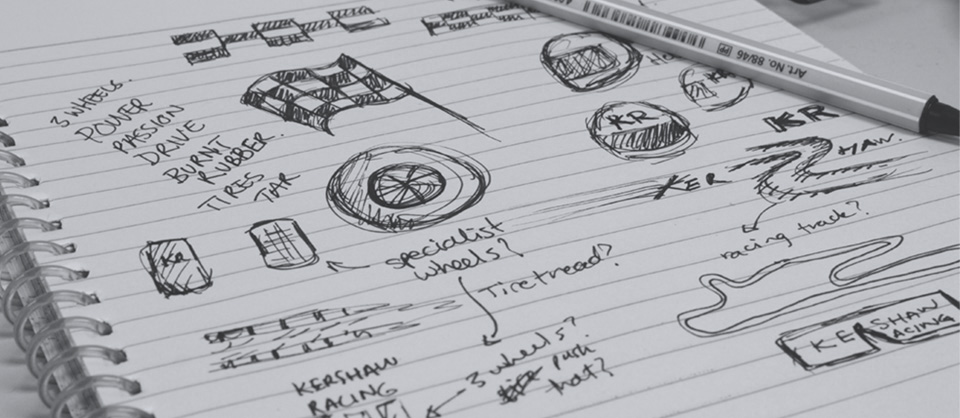 Hand drawn sketches showing part of the logo design process