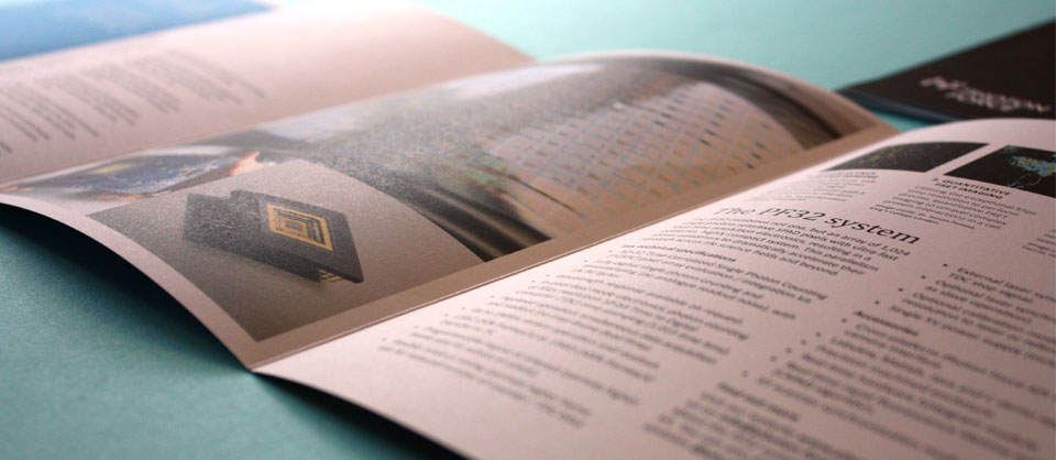 The brochure opened out full to show balanced layout of text and images